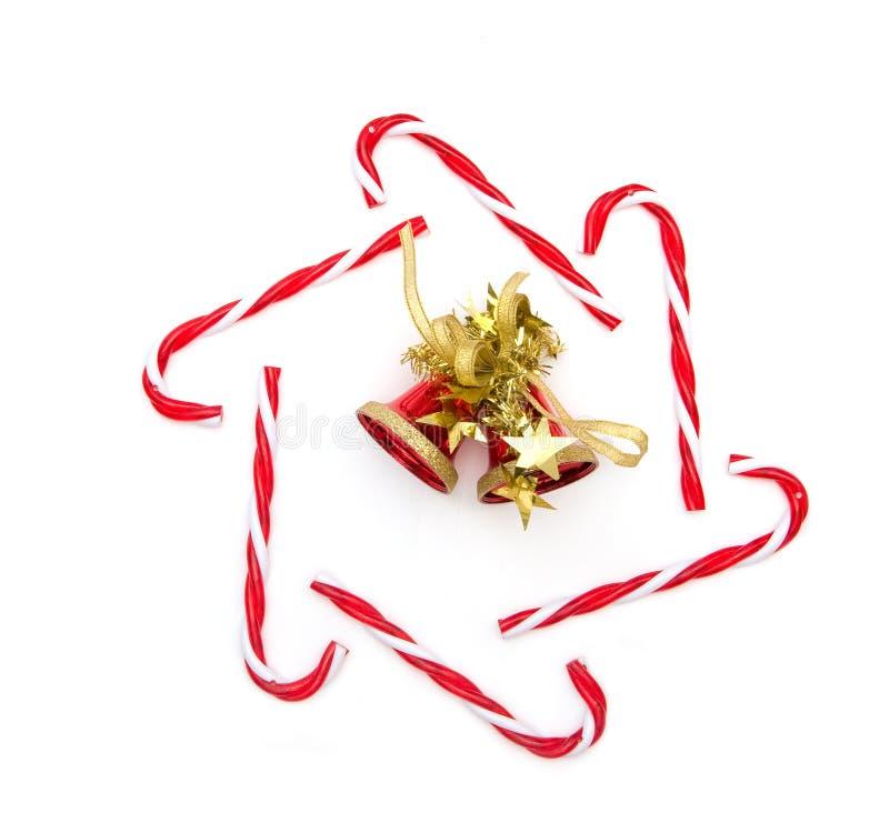 Canne et cloche de sucrerie de Noël image libre de droits