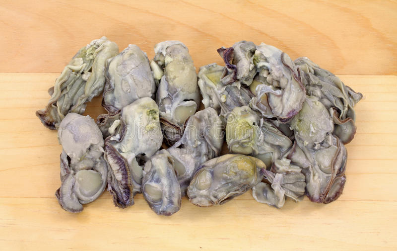 Canned Boiled Oysters on Cutting Board