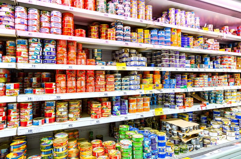 Canned fish in cans for sale in hypermarket royalty free stock photos