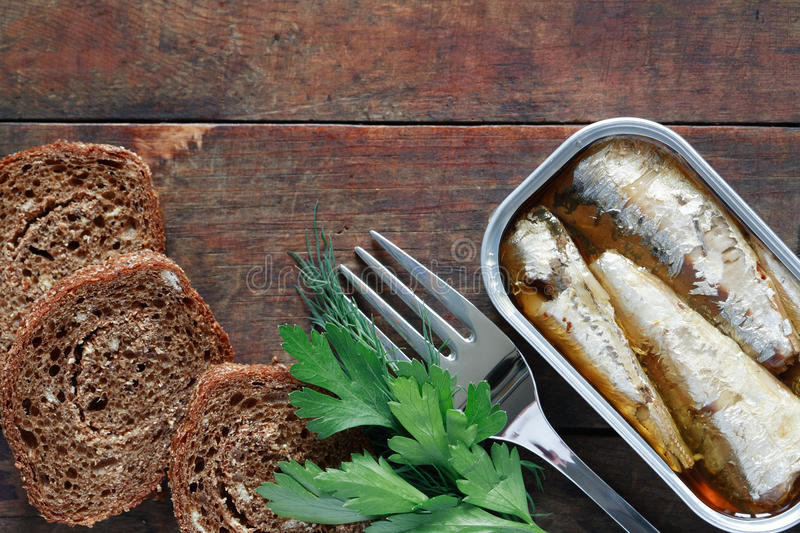 Canned Fish On Wood stock photos