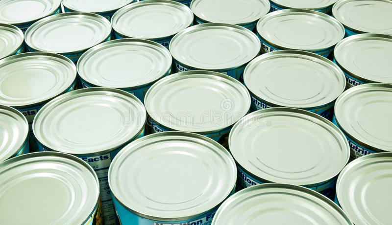 Canned food. Stocking Up - A row of shiny canned food royalty free stock photo