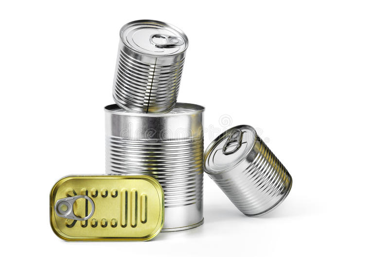 Canned Food. Pile of cans of conserved food over white background royalty free stock photo