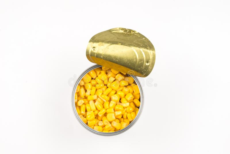 Canned food on white background. Sweet corn stock photos