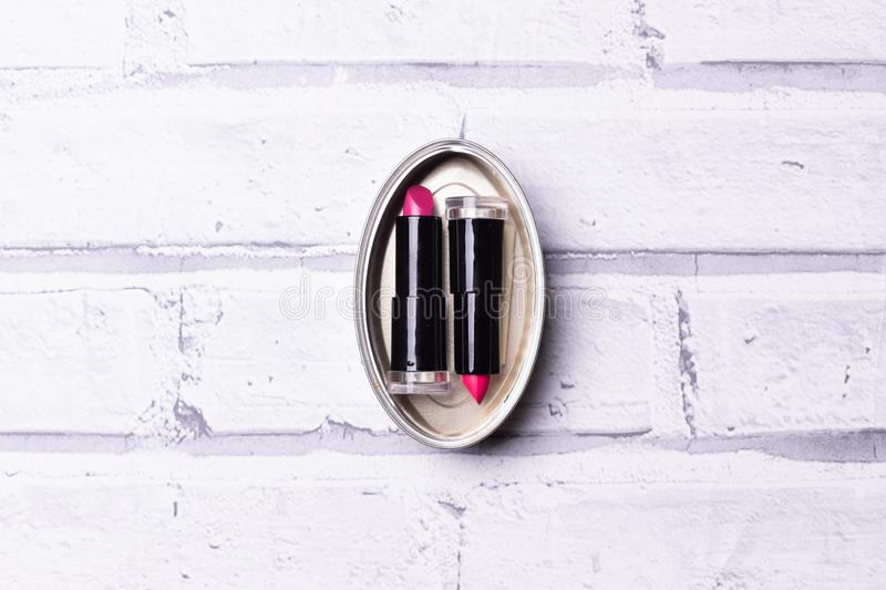 Canned lipsticks red in the wall royalty free stock photo