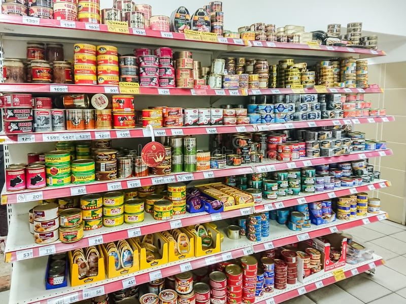 Canned meat and fish on the shelves in the grocery supermarket. stock photography