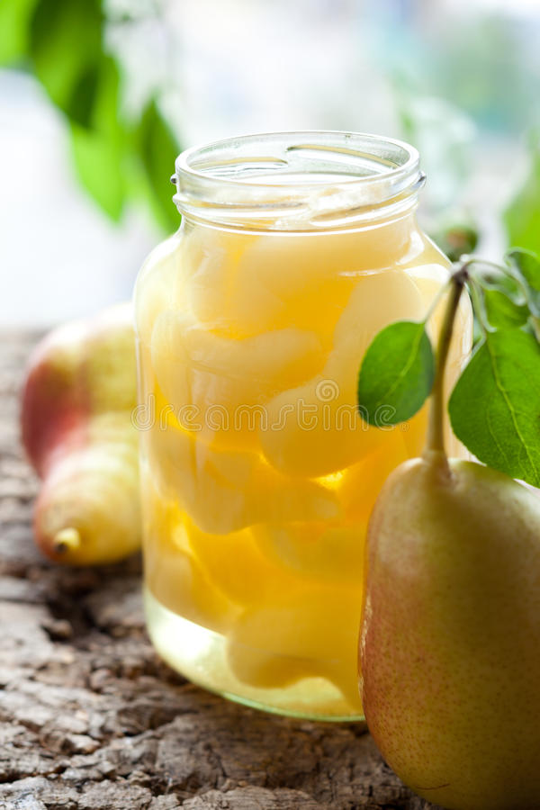 Canned pear compote. In jar stock photography