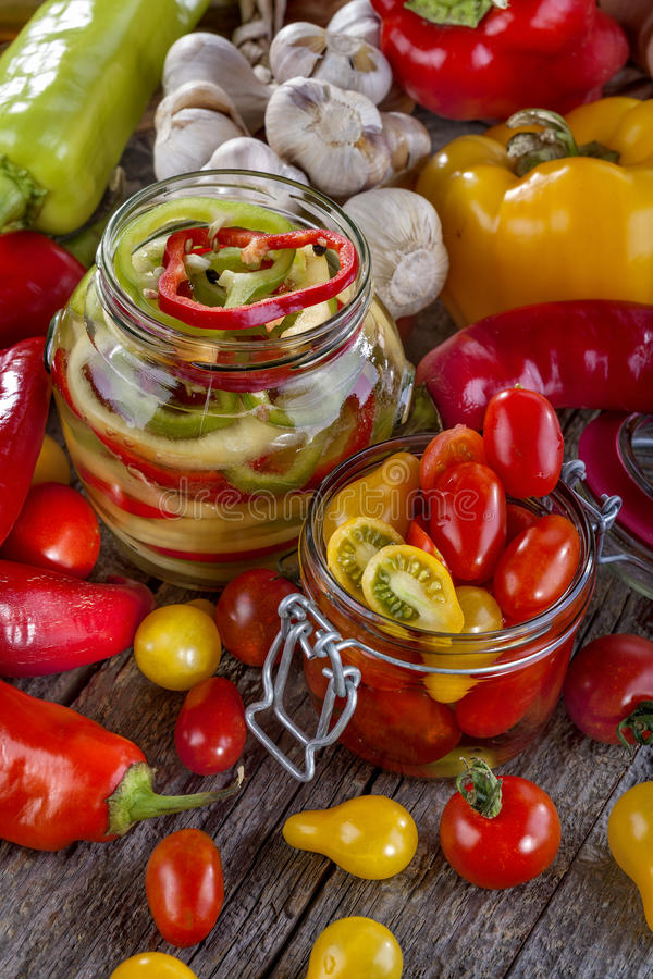 Canned pepper and tomato stock images