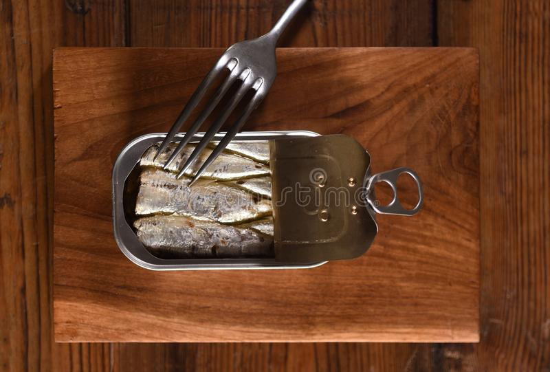 Canned sardine on wooden. Table royalty free stock photography