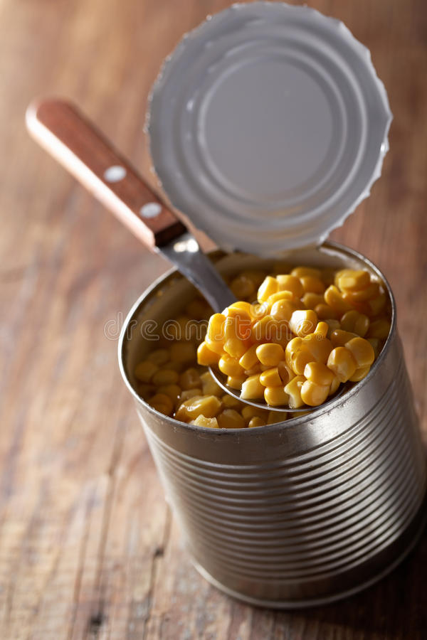 Canned sweet corn. In a can closeup stock photos