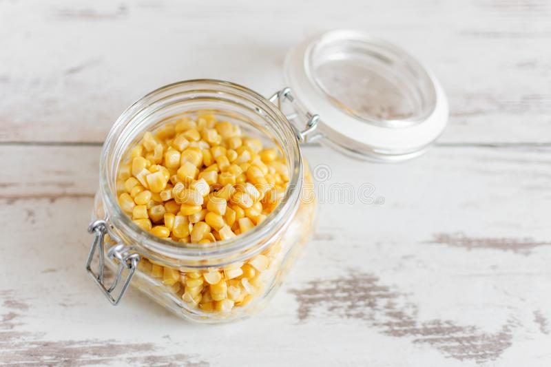 Canned sweet corn in glass jar stock photography