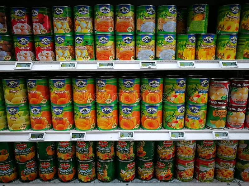 Canned tinned fruit section in gourmet supermarket royalty free stock images