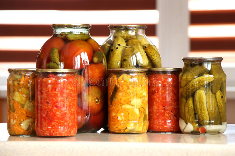 Canned tomatoes and cucumbers royalty free stock image