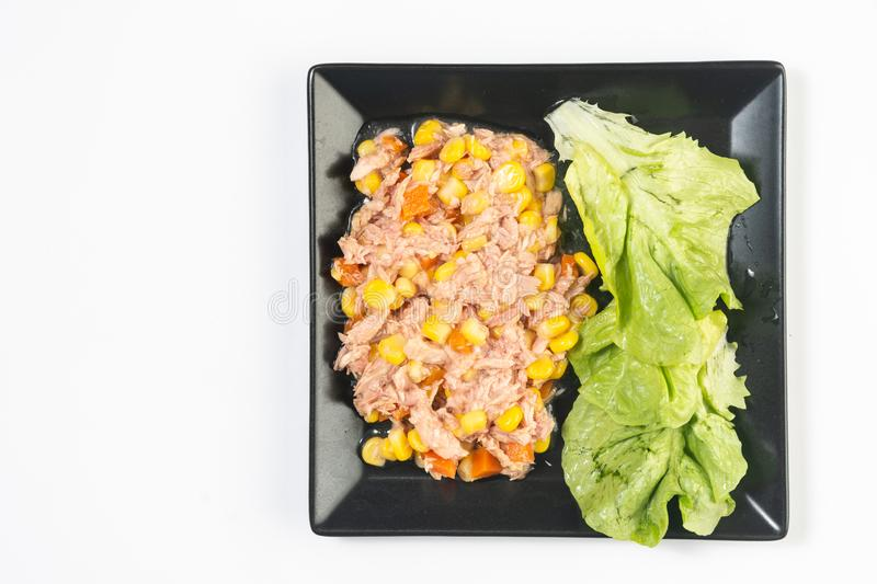 Canned Tuna fish with corn and tomato and lettuce salad royalty free stock images