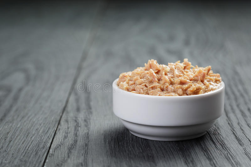 Canned tuna in white bowl on wood table stock photos