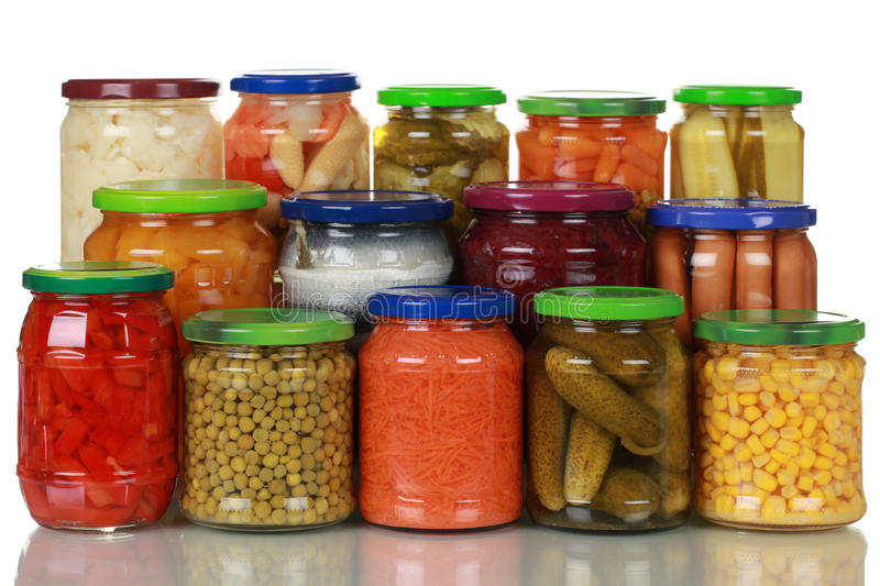 Vegetables in glass jars royalty free stock photography