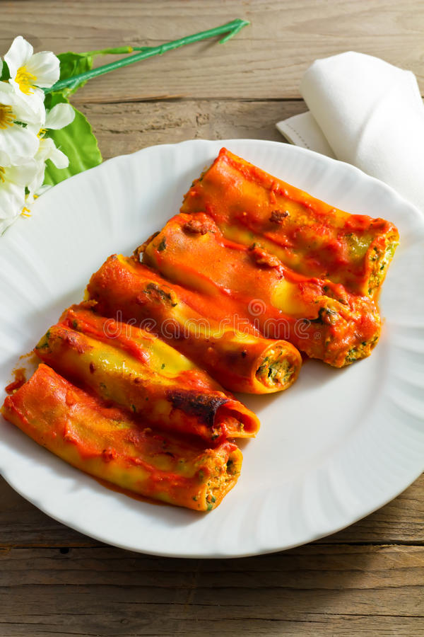 Cannelloni with ricotta and spinach stock photography