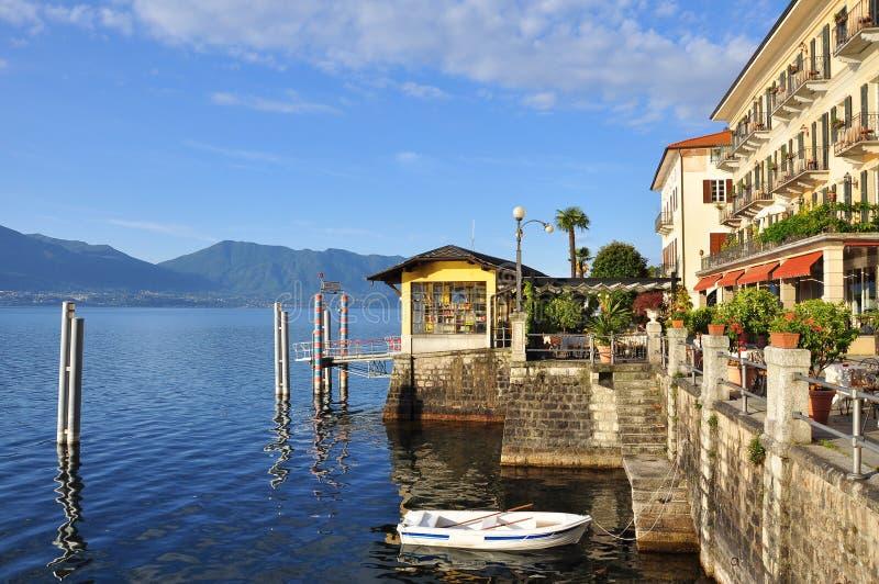 Cannero Riviera lakefront promenade, Lake - lago - Maggiore, Italy. The waterfront of Cannero Riviera resort, Lake - lago - Maggiore, Italy. Boat Pier and royalty free stock photo