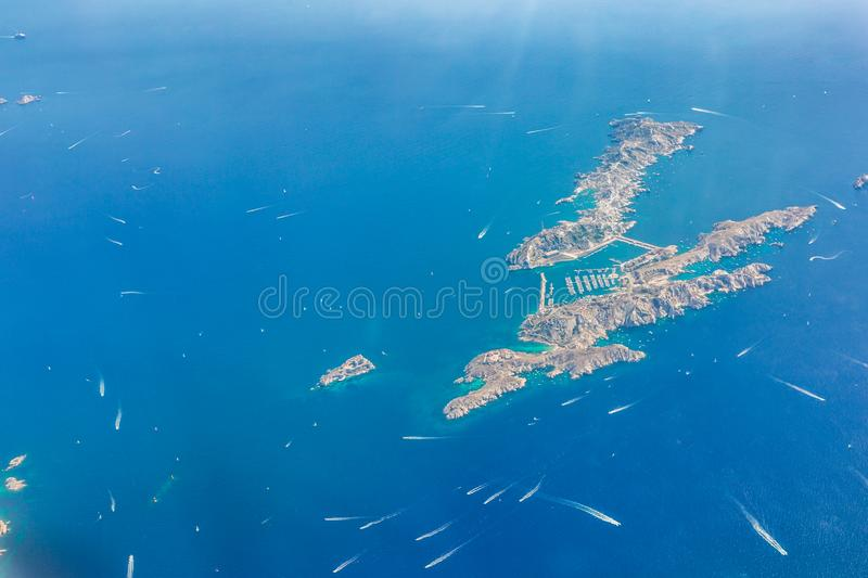 Aerial landscape of small island with sailboats and speedboats close to coast of French Riviera. Cannes aerial view. Cote d`Azur, French Riviera from sky. Monte royalty free stock photo