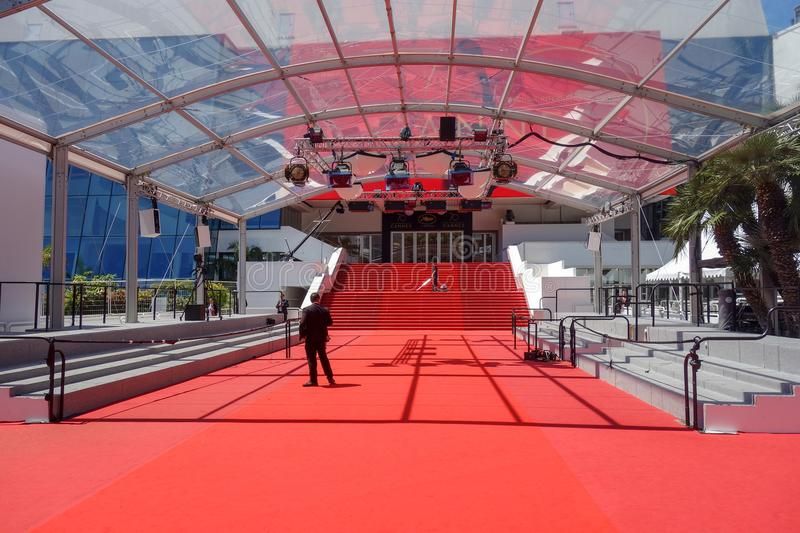 CANNES, FRANCE — MAY 19, 2017: A man vacuums the red carpet steps at the entrance of The Grand Theatre Lumiere. stock photos