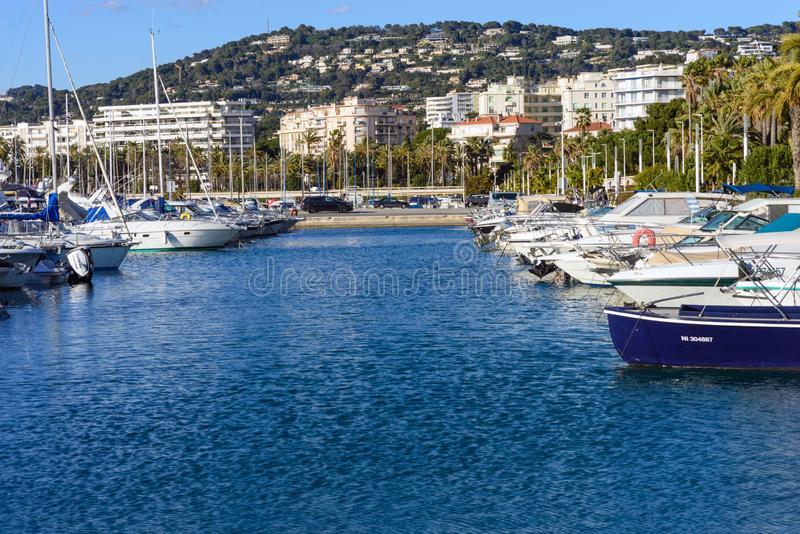Cannes, France, March 2019. White expensive yachts on a background of mountains on a sunny day. Yacht parking in Cannes, France. stock photos