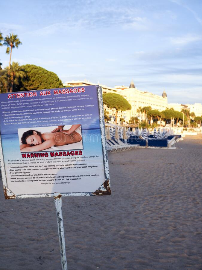 EDITORIAL massage warning sign on health danger Cannes France French Riviera royalty free stock photo