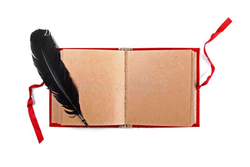 Cannette sur le vieux livre vide d'isolement sur le blanc photo stock