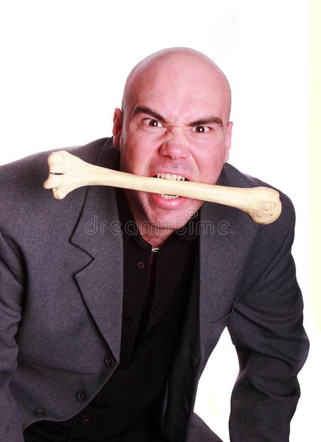 Cannibal man. In suit eating bone royalty free stock photo