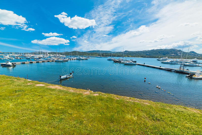 Cannigione harbor on a clear day. Sardinia stock images
