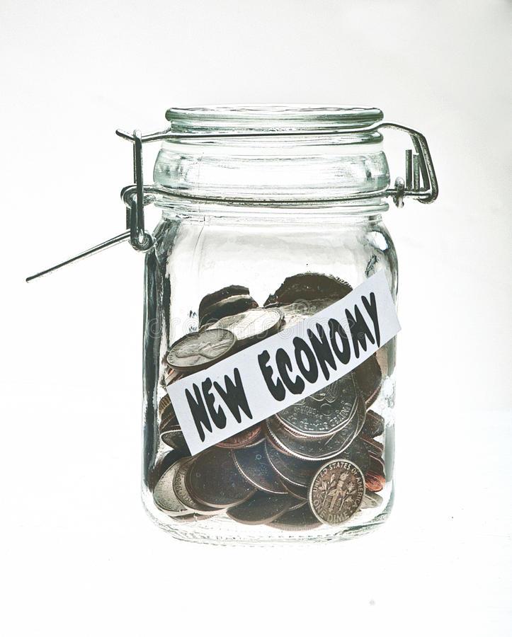 A canning jar filled with coins stock image
