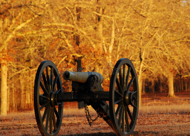 Cannon. An America Civil War cannon sits in a meadow in the late autumn in Shiloh National Military Park in southern Tennessee, United States royalty free stock photo