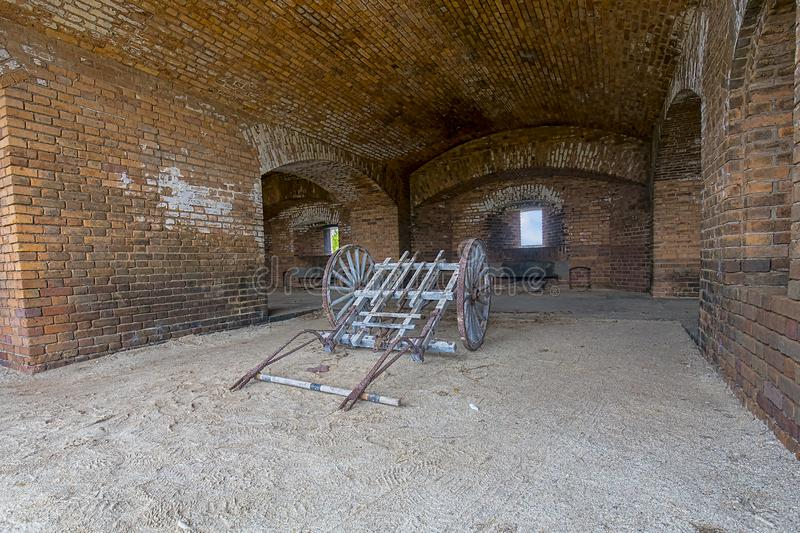 Cannon Artillery Cart. An old cannon artillery cart inside a cannon hole of Fort Jefferson at Dry Tortugas stock photography