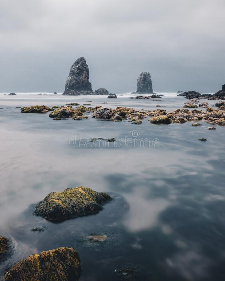 Cannon Beach is a city in Clatsop County, Oregon, United States, dramatic weather before a rain storm, tourism, Travel USA, sand,. Landscape, cityscape stock image