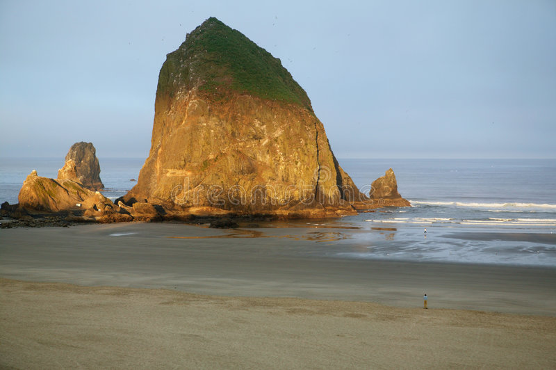 Cannon Beach, Haystack Rock, Oregon. First light just hitting Haystack Rock at Cannon Beach, Oregon. This is a nine-mile wide sandy beach, that features Haystack royalty free stock photo
