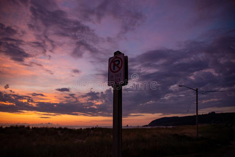 Cannon Beach at sunset: scenic orange, red and purple skies.  royalty free stock photo