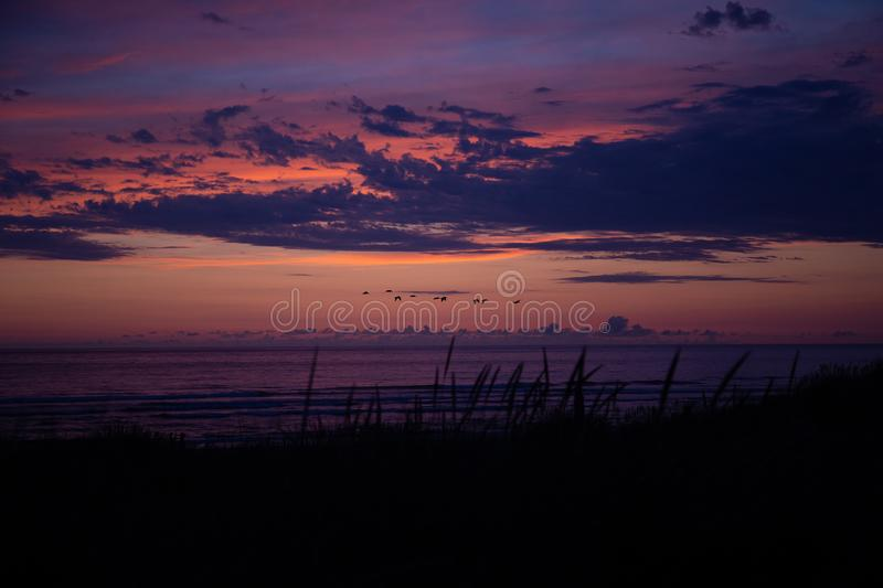 Cannon Beach at sunset: scenic orange, red and purple skies.  royalty free stock photos