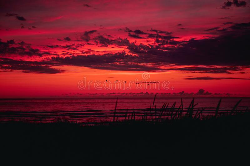 Cannon Beach at sunset: scenic orange, red and purple skies.  stock photo