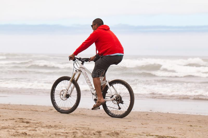 Men in a red hoodie on a bike royalty free stock photos