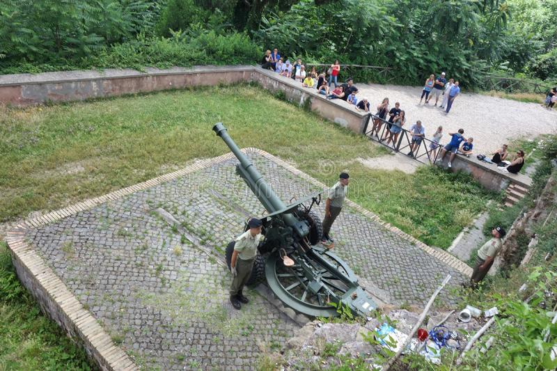 Cannon fires blanks at noon. ROME, ITALY - JUNE 15, 2016: people assist at the cannon fire at noon on the janiculum hill stock image