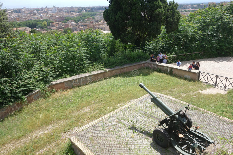 Cannon fires blanks at noon. ROME, ITALY - JUNE 15, 2016: people assist at the cannon fire at noon on the janiculum hill stock photo