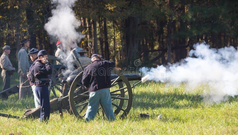 Cannon firing during American Civil War Reenactment. MCCONNELLS, SC USA - November 3, 2018: A cannon fires during a Civil War battle reenactment at Historic stock photos
