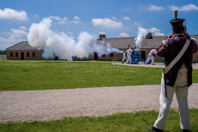Cannon firing, fort snelling. Inside the walled fortification of historic fort snelling, costumed soldiers reinact thier way of life from the middle 1800's stock photo
