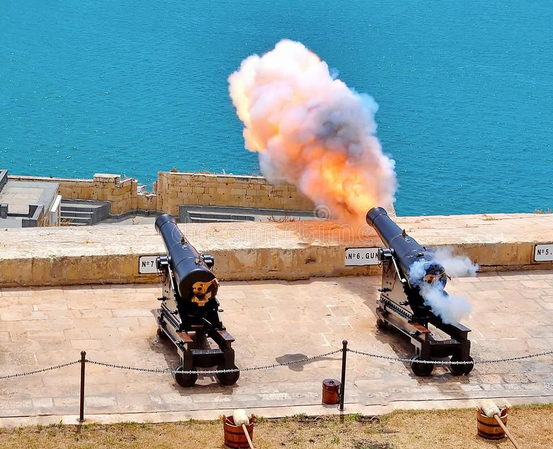 Cannon Firing. Cannon firring in old fort of Valletta royalty free stock photo