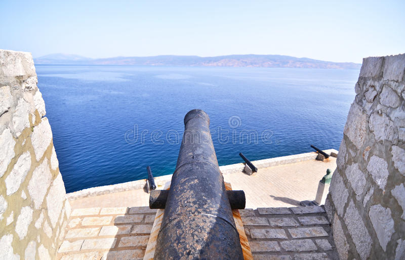 Cannon of the fortification of Hydra island Greece stock images
