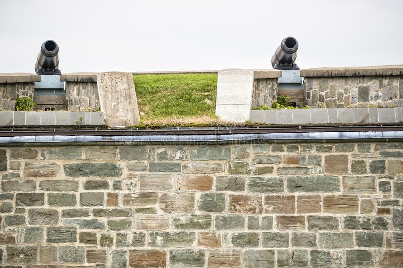 Cannon Fortifications inside the Citadel in Quebec City Canada. On top of fortified rock wall royalty free stock images