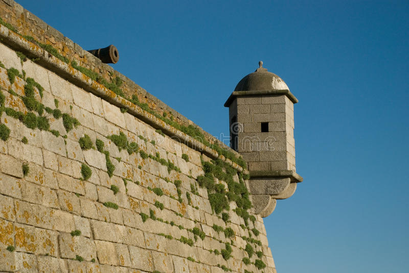 Cannon at the fortress edge stock photography