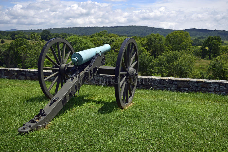 Cannon overlooking. An old cannon overlooks the valley below it royalty free stock photography