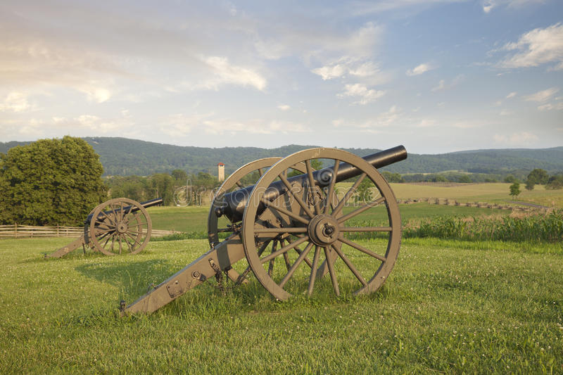 Cannons at Antietam (Sharpsburg) Battlefield in Maryland. Cannon at Antietam (Sharpsburg) Battlefield in Maryland with the fence of Bloody Lane, also known as stock photo