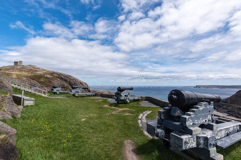 Cannons and Cabot Tower on Signal Hill, St. John`s, Newfoundland. The Cabot Tower overlooks the harbor of St John`s, Newfoundland. Historically this tower stock image