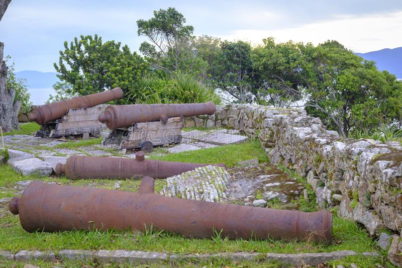 Cannons. Looking towards the atlantic ocean from the fortress in florianopolis stock photo
