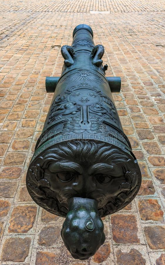 Cannons at Les Invalides museum complex in Paris, France burial site for France`s war heroes and emperor Napoleon Bonaparte`s tomb. Detail of old cannons at the royalty free stock images